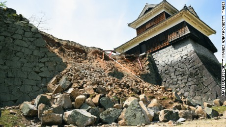 KUMAMOTO, JAPAN - APRIL 15:  The stone wall of Kumamoto Castle is seen damaged by the earthquake on April 15, 2016 in Kumamoto, Japan. Kumamoto Castle is a major tourism destination and one of the country's Important Cultural Properties. As of April 15 morning, at least nine people died in the powerful earthquake with a preliminary magnitude of 6.4 that struck Kumamoto Prefecture on April 14, 2016.  (Photo by Masterpress/Getty Images)