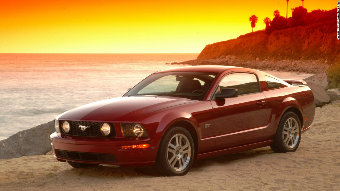The fifth-generation Mustang reverted to a sleeker fastback and shark-bite front with round headlamps, recalling the first generation models.