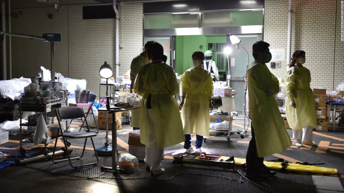 Medical staff prepare to evacuate patients from the hospital in Kumamoto City on April 16, over fears it could collapse as a wave of aftershocks hit the area.