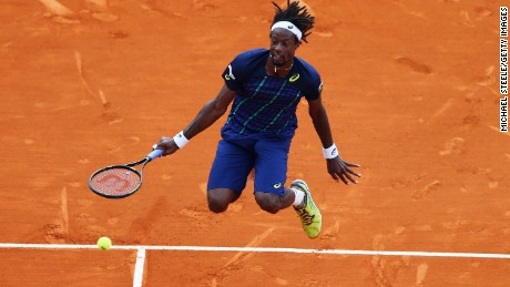 Gael Monfils with a typically acrobatic effort during his final against Nadal in Montel Carlo.