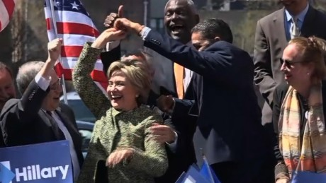 Hillary Clinton dances on stage with NY officials