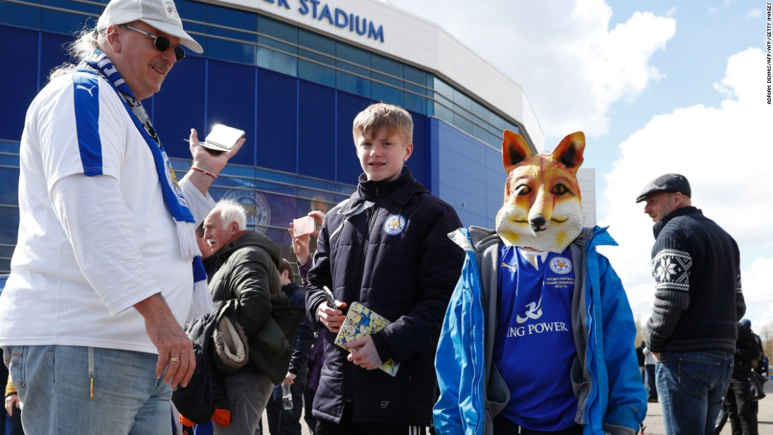 A young fan wears a fox mask outside the stadium before kick off of the English Premier League football match between Leicester City and West Ham United at King Power Stadium in Leicester.