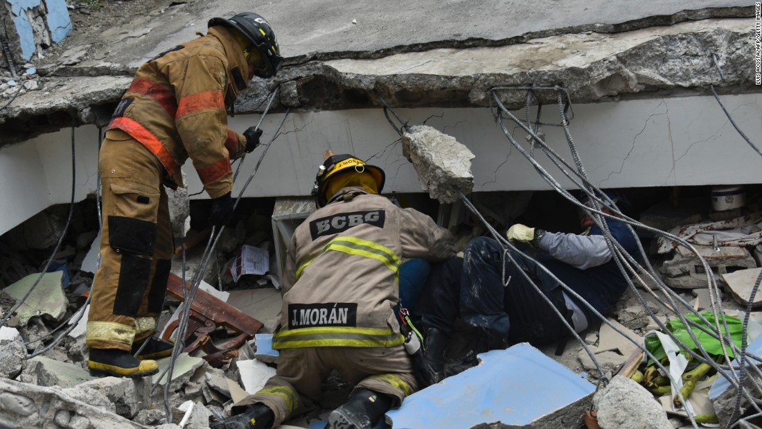 Rescue workers search the rubble of a collapsed building for victims in Guayaquil, Ecuador, on April 17.