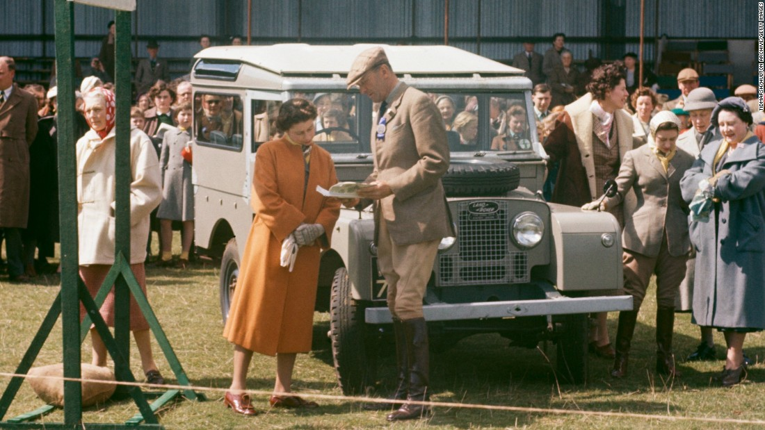 Queen Elizabeth II's relationship with Land Rover extends back to 1948, when her father King George VI was presented with the 100th production vehicle. Pictured is Her Majesty in 1956 at the Badminton Horse Trials in Gloucestershire, England.