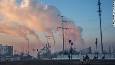 Smoke billows from a coal-fired power plant in November in Shanxi, China.