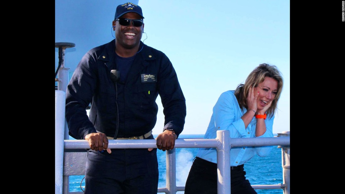 "Brooke alongside <a href=""http://www.cnn.com/2016/01/19/living/person-who-changed-my-life-brooke-baldwin/"" target=""_blank"">longtime friend, Lt. Cmdr. Bobby Rashad Jones</a>, XO on USS Anzio. (Brooke says the weapons testing was loud!)"