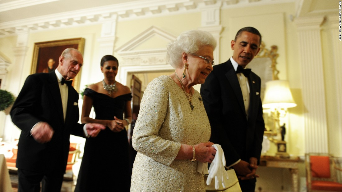 President Barack Obama sees off Queen Elizabeth II, as the Duke of Edinburgh and the first lady follow after a reciprocal dinner at the Winfield House in London, on May 25, 2011.