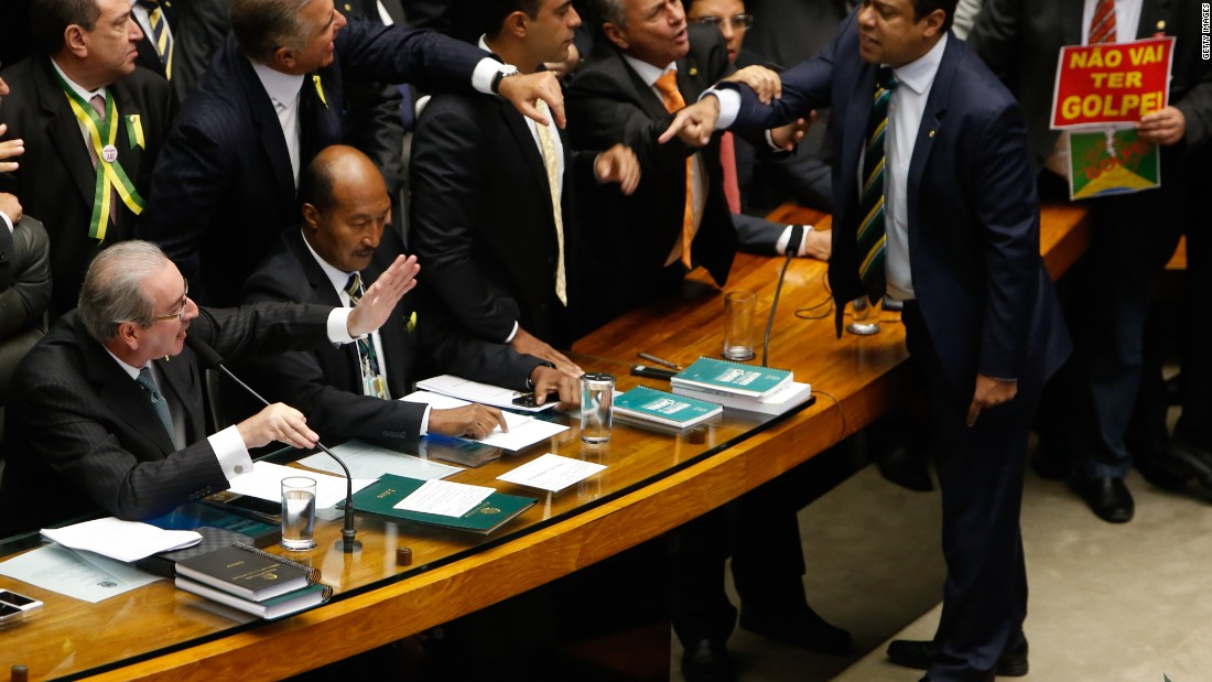Deputies of the Lower House of Congress exchange words during the vote. After the success of the motion to impeach, it will be considered by the parliament's upper house.
