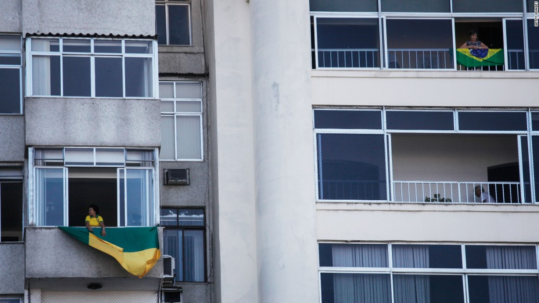 Brazilian flags hang from apartments during demonstrations on the day of voting.