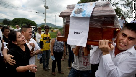 Pallbearers carry a coffin to a nearby cemetery, as relatives mourn the loss of their family members, victims of the 7.8-magnitude earthquake, in Portoviejo, Ecuador, Monday, April 18, 2016.
