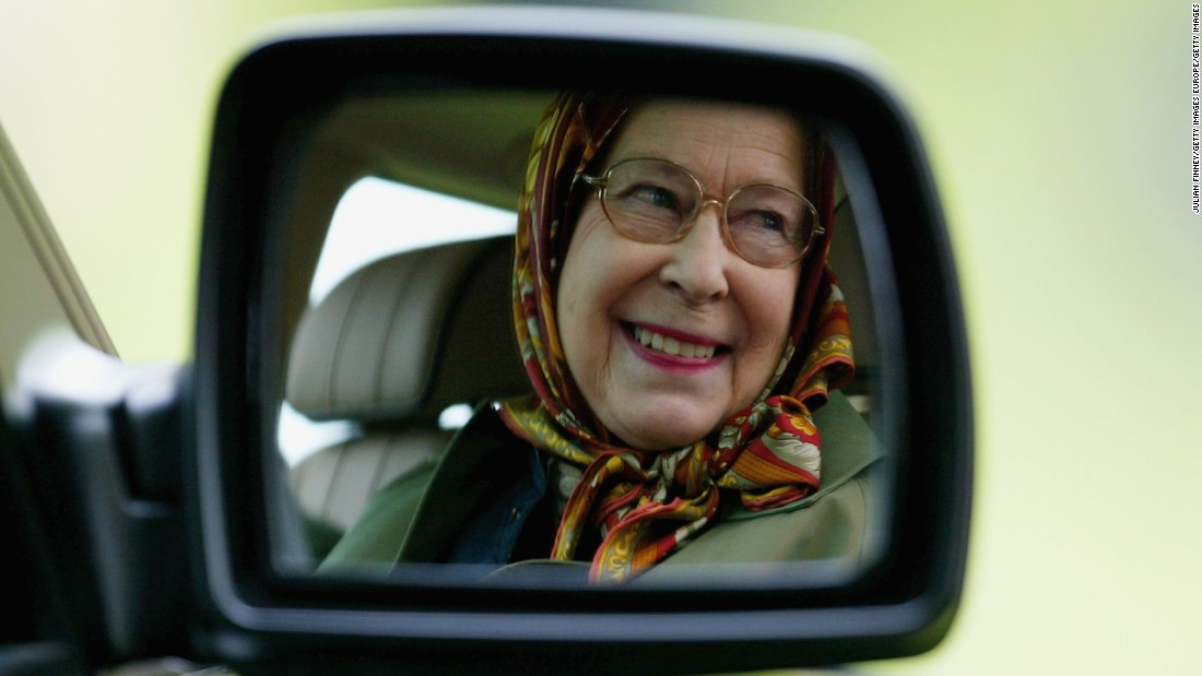 "The Queen has often been pictured behind the wheel of Land Rovers, particularly on her estates. In one <a href=""http://www.buzzfeed.com/patricksmith/im-the-queen-mate-im-driving#.asmmbgQ87k"" target=""_blank"">famous anecdote</a> which reemerged after the death of Saudi King Abdullah, Her Majesty was said to have driven the then-prince around her Balmoral estate in 1998. Not used to a woman behind the wheel and concerned with her speed, through an interpreter Prince Abdullah ""implored the Queen to slow down and concentrate on the road ahead"" according to former Ambassador Sherard Cowper-Coles.<br /><br />Here, Queen Elizabeth II is seen reflected in the wing mirror of her Land Rover."
