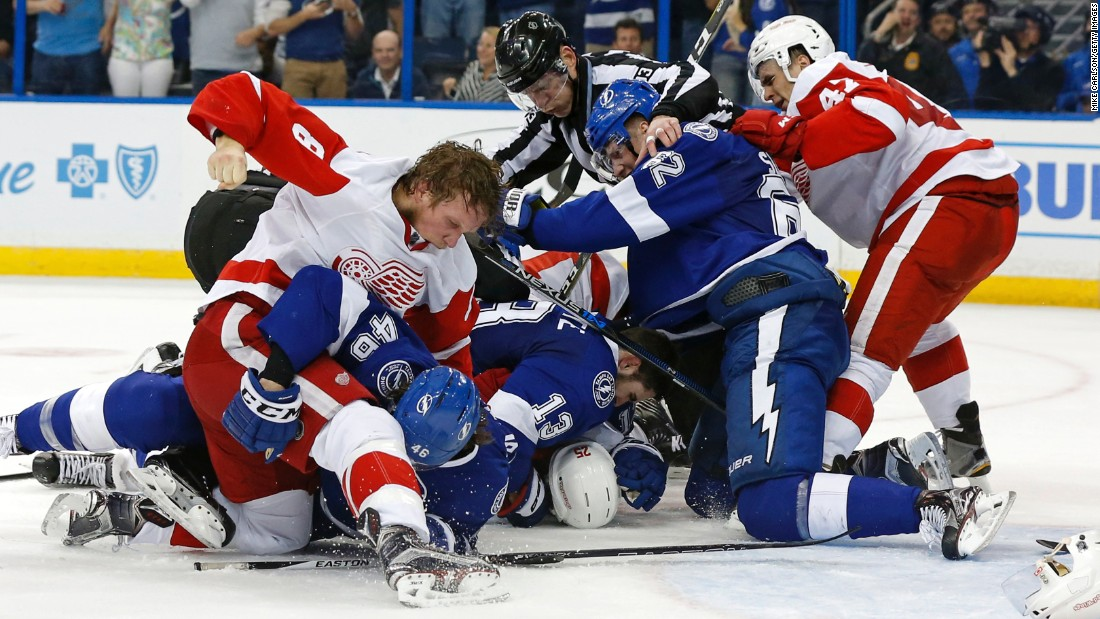Detroit Red Wings and Tampa Bay Lightning players fight during the third  period in Game Two of the 2016 NHL Stanley Cup Playoffs at Amalie Arena in Tampa, Florida, on April 15. The Lightning defeated the Red Wings 5-2.