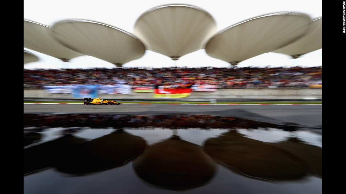 "Jolyon Palmer of Great Britain drives on track during qualifying for the <a href=""http://edition.cnn.com/2016/04/17/motorsport/chinese-gp-rosberg-vettel-kvyat/"">Formula One Grand Prix of China</a> at Shanghai International Circuit on April 16."