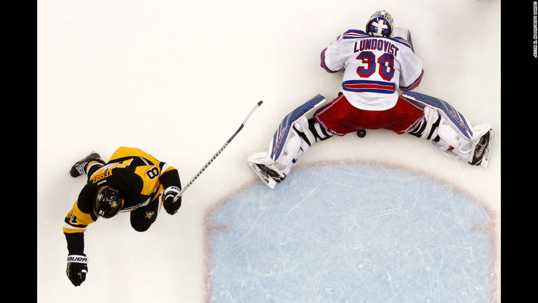 No. 81 Phil Kessel of the Pittsburgh Penguins scores past No. 30 Henrik Lundqvist of the New York Rangers in the second period in Game Two of the 2016 NHL Stanley Cup Playoffs at Consol Energy Center in Pittsburgh on April 16.