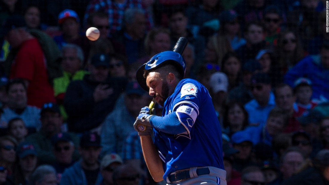 Chris Colabello of the Toronto Blue Jays is hit in the head by a pitch thrown by Steven Wright of the Boston Red Sox during the fourth inning at Fenway Park in Boston on April 17.