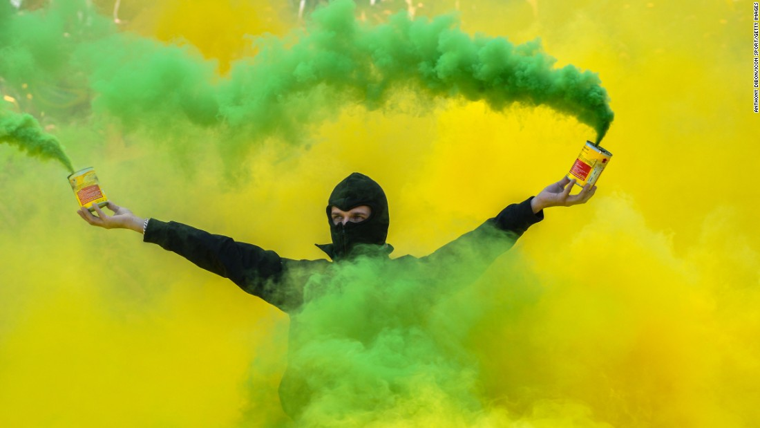 A fan of Nantes holds smoke flares during the French Ligue 1 between Nantes and Montpellier at Stade de la Beaujoire on April 17.