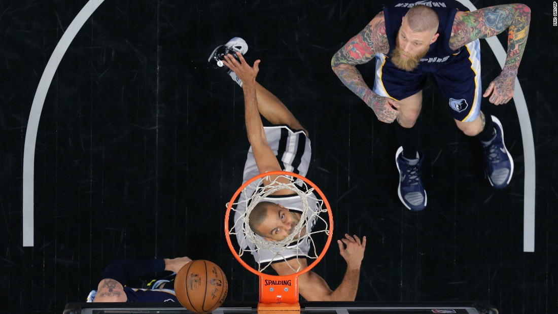 San Antonio Spurs guard Tony Parker, center, scores past Memphis Grizzlies forward Chris Andersen, right, during the second half in Game 1 of a first-round NBA basketball playoff series on Sunday, April 17, in San Antonio.