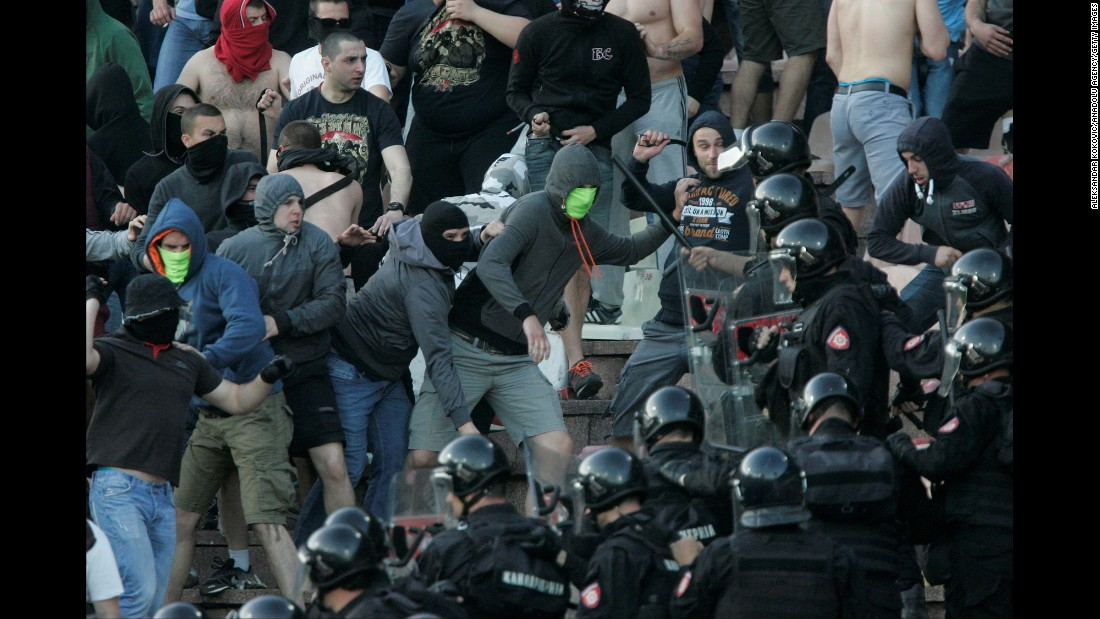 Police intervene after fans on both sides began throwing chairs at one another during the Serbian Super League play off match between Red Star Belgrade and FK Partizan in Belgrade on April 16.
