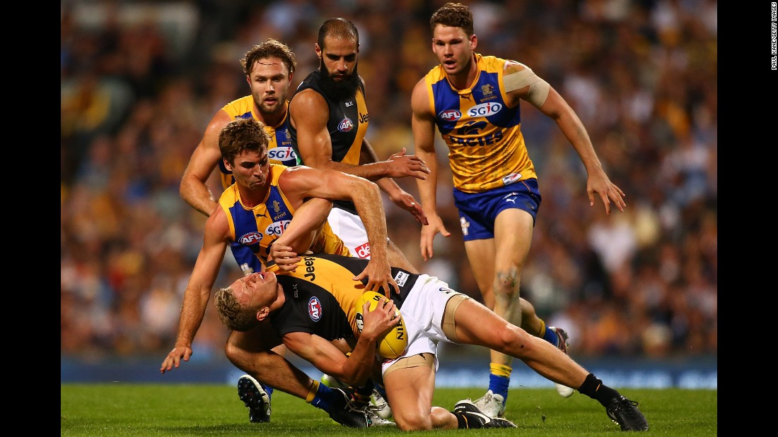 Taylor Hunt of the Richmond Tigers gets tackled by Jamie Cripps of the West Coast Eagles during the round four AFL match at Domain Stadium in Perth, Australia, on April 15.