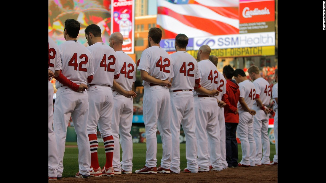 "St. Louis Cardinals players stand for the national anthem before their game against the Cincinnati Reds at Busch Stadium in St. Louis, Missouri, on April 15. All players wore No. 42 jerseys in honor of Jackie Robinson Day. <a href=""http://www.cnn.com/2016/04/12/sport/gallery/what-a-shot-sports-0412/index.html"" target=""_blank"">See 29 amazing sports photos from last week</a>"