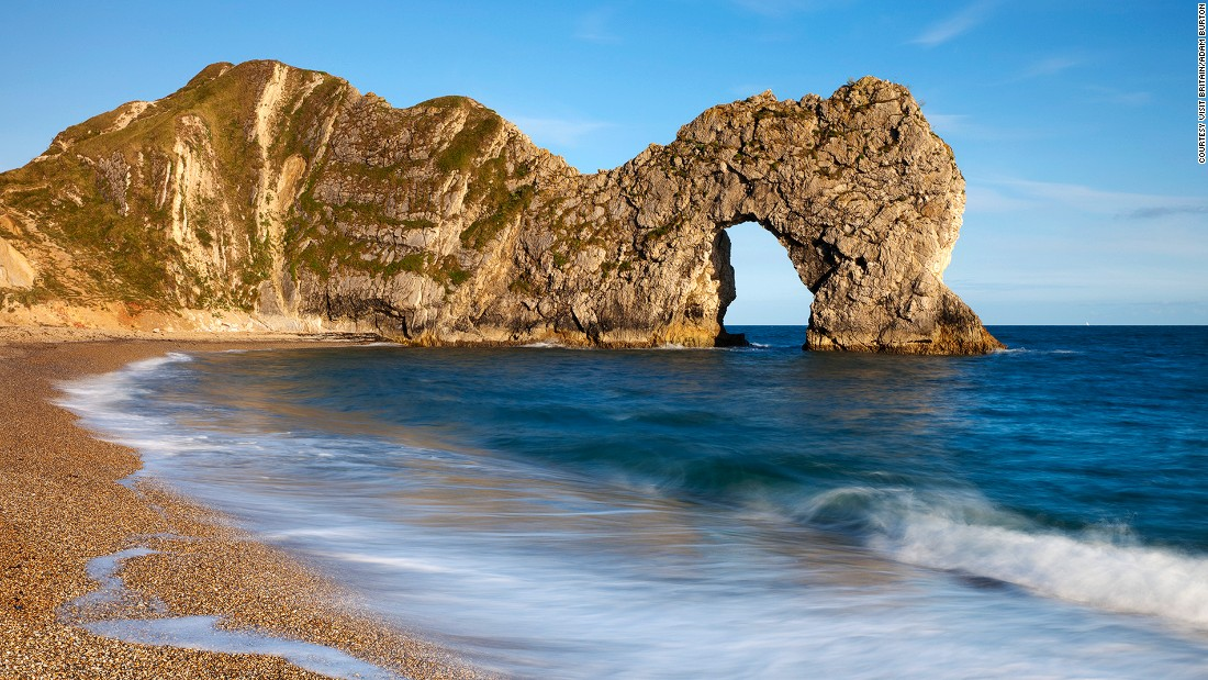 "Some rocks and fossils found in the <a href=""http://jurassiccoast.org/about/"" target=""_blank"">Jurassic Coast</a>, covering southern England's Dorset and East Devon, are 185 million years old. It's England's first natural World Heritage Site. Durdle Door (pictured here) is an iconic natural limestone arch on the beach."
