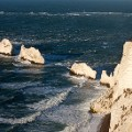 Beautiful England 25 The Needles are five isolated rocks in a line reaching out in the sea, off the coast of the Isle of Wight close to Alum Bay©VisitBritain: Adam Burton