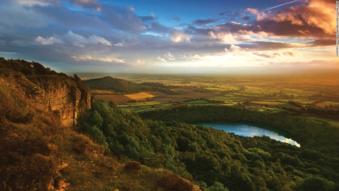 "Sutton Bank is where the heather-clad <a href=""http://www.northyorkmoors.org.uk/"" target=""_blank"">North York Moors</a> give way to gorgeous views over the pancake-flat Vale of York. It's one of the three Dark Sky Discovery Sites in the area for star-gazing."