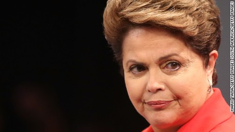 RIO DE JANEIRO, BRAZIL - OCTOBER 24:  Brazilian President and Workers' Party (PT) candidate Dilma Rousseff (R) waves to the audience prior to the debate with Presidential candidate of the Brazilian Social Democratic Party (PSDB) Aecio Neves on October 24, 2014 in Rio de Janeiro, Brazil. The two are squaring off in a run-off election on October 26. (Photo by Mario Tama/Getty Images)
