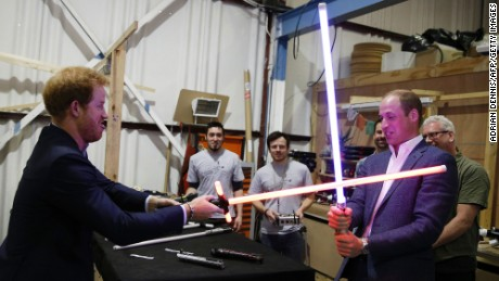 Britain's Prince Harry and Prince William, Duke of Cambridge try out light sabers during a tour of the Star Wars set at Pinewood Studios in Iver Heath, England, on Tuesday, April 19.
