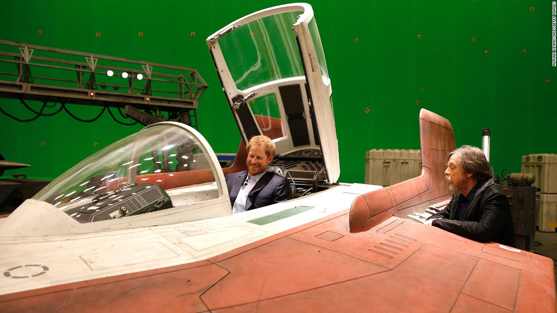 Harry sits in an A-wing Fighter as he talks with actor Mark Hamill.