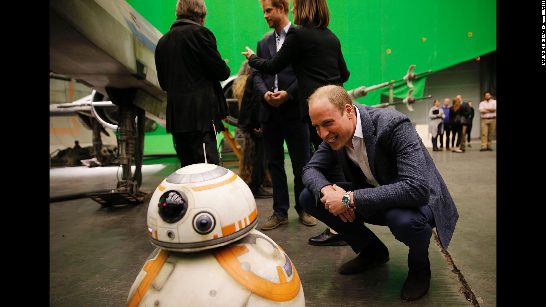 William smiles at a BB-8 droid during the tour.