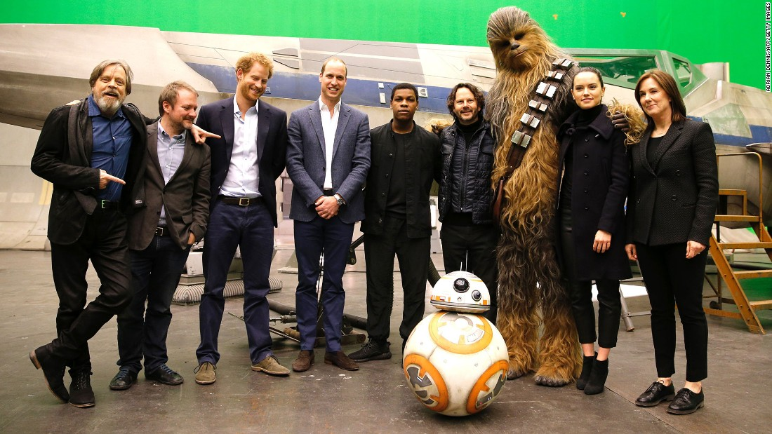 Hamill, director Rian Johnson, Harry, William, Boyega, producer Ram Bergman, Chewbacca, actress Daisy Ridley and producer Kathleen Kennedy pose for a photo.