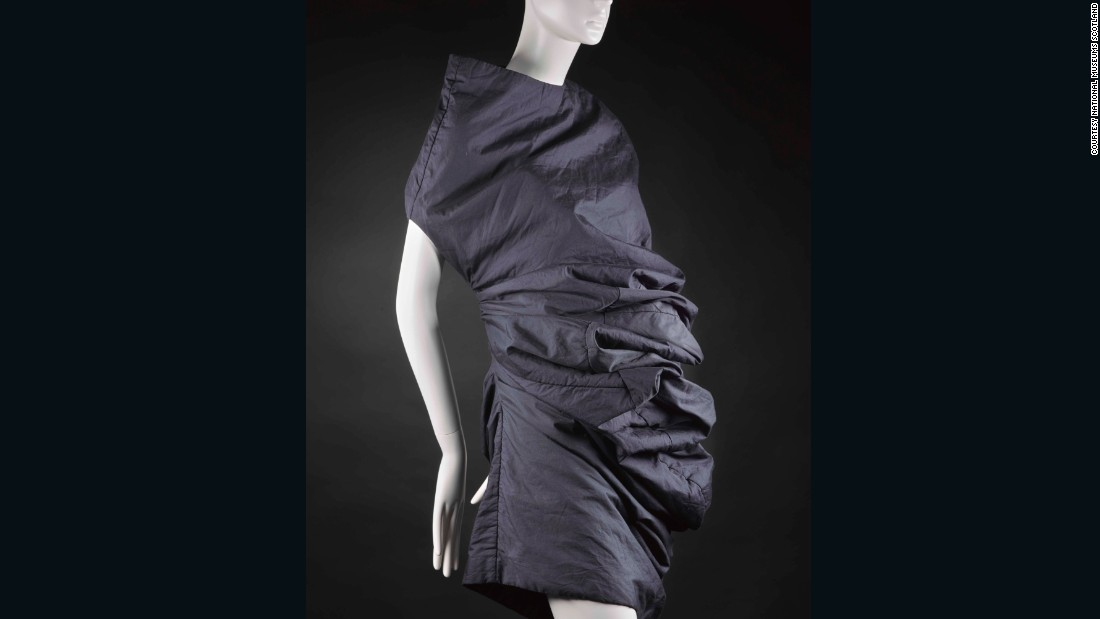 "One of the most influential avant-garde designers of the 1980s, Rei Kawakubo is renowned for exploring the boundaries of clothing and we therefore just had to represent her work in the ""Cutting Edge"" section of the gallery. <br /><br />This sample garment for her landmark ""Bump"" collection plays with the space between the fabric and the contours of the body. Lightly padded and reinforced with tulle to hold its curves, it critiques the notion of there being one ideal female shape. It's a fantastic piece for us to have on display in a gallery where body image is also a central theme."