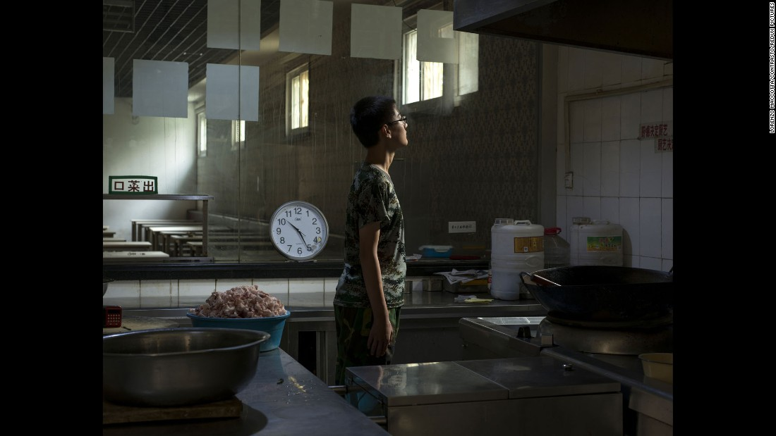 A 14-year-old internee spends time in the kitchen. He had been living at the center for two months.