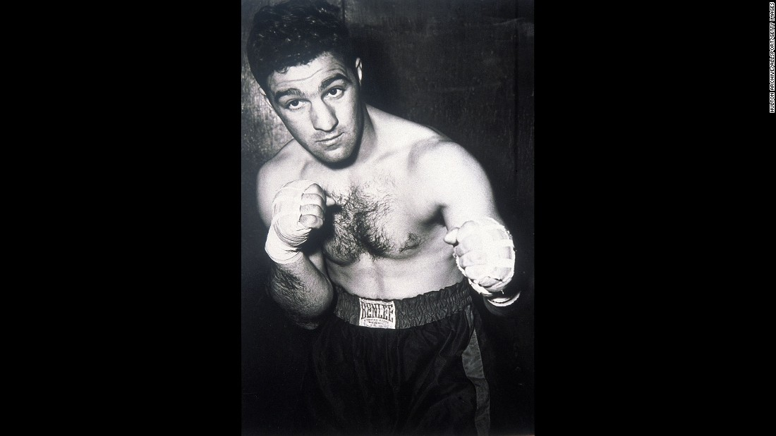 World heavyweight champion Rocky Marciano, seen here in 1955, announced on April 27, 1956, that he was retiring from boxing at age 31. Marciano, who had a perfect 49-0 record with 43 knockouts, said he wanted to spend more time with his family. He died in a plane crash in 1969 at age 45.