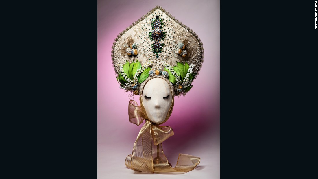 "When we approached New York-based milliner Anya Caliendo for a hat for our ""Cutting Edge"" section, we were thrilled when she decide to create a bespoke piece especially for us. It was inspired by the culture of Caliendo's native Russia, created in the style of a traditional Russian headdress. <br />This hand-made piece incorporates unique millinery techniques without using a single machine stitch or drop of glue, and took over three weeks to complete.  The use of Italian shimmering gold silk, French flocked lace and Swarovski pearls and crystals helps to create an impression of early spring in Russia, as the first signs of nature push up through a covering of snow."