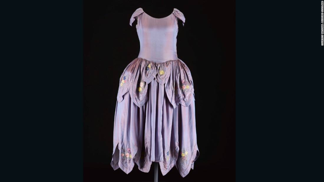In the 1920s, Jeanne Lanvin became known for her <em>robe de style</em> with its full pannier hips, and her trademark use of intricate trimming and embroideries in light floral colors. <br /><br />In an example of successful brand marketing, the illustrator Paul Iribe sketched Jeanne and her daughter both wearing a dress in this style, and the image has been used as the logo for the house since 1927.  <br /><br />We acquired this dress recently from a vintage haute couture specialist in London to enable us to tell this story.  It offers an eye-catching contrast to the androgynous flapper style that we usually associate with the decade.
