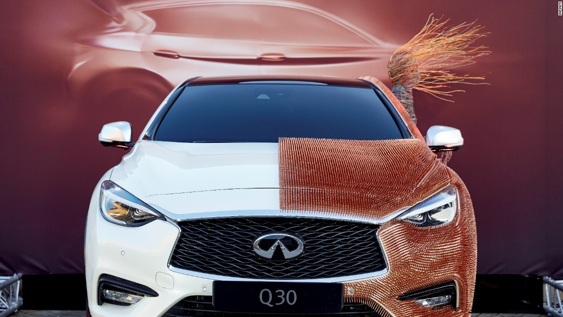 British artist Rachel Ducker stuck 48,000 copper tacks onto an Infiniti Q30 to create this<em> Inspired Q30</em> car art.