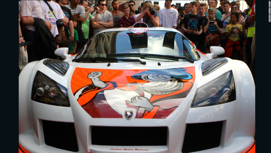 It took tattoo artist Aleksy Marcinow two weeks to ink this Gumpert Apollo supercar - one of the world's first tattooed cars. It's on show at the London Motor Museum.