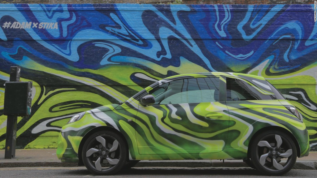 Contemporary British artist Josh Stika's street artwork, featuring a Vauxhall Adam, was on show in Shoreditch, East London, during May 2015.