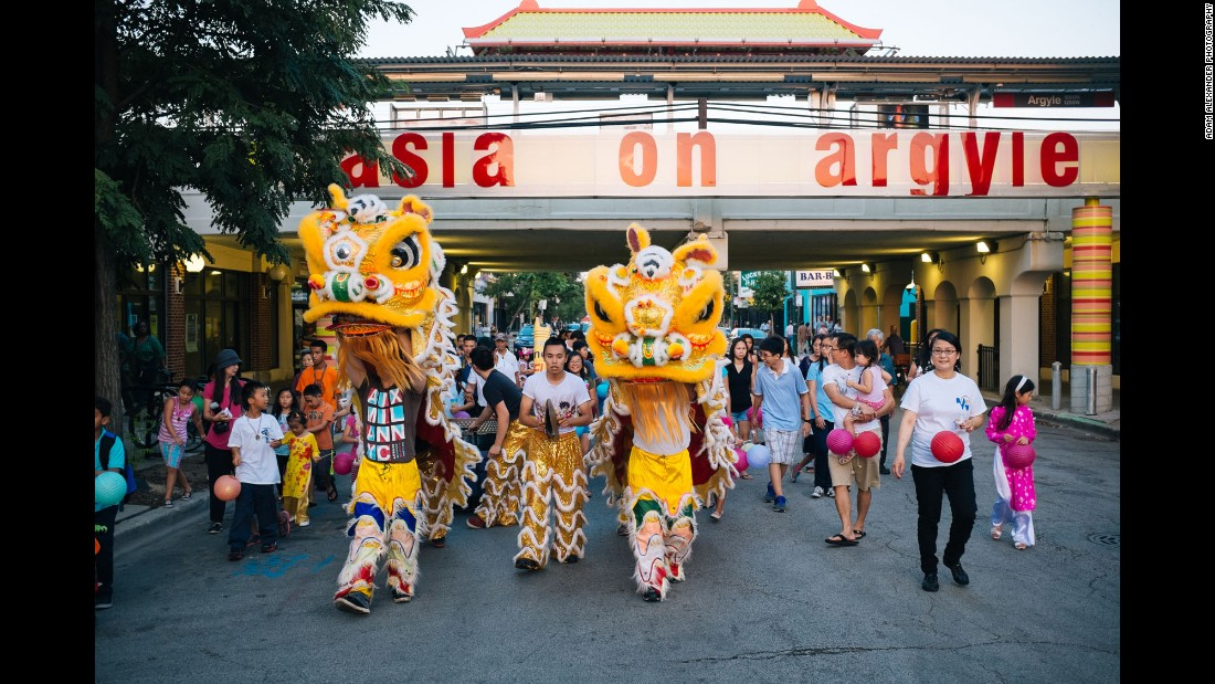 Chinese lions march through a night market in Little Saigon's Uptown neighborhood, which is known as having the best Vietnamese food in the city.