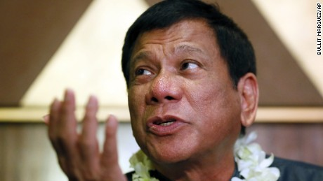 """FILE - In this March 10, 2016 file photo, Davao City Mayor Rodrigo Duterte talks to the media prior to addressing seafarers organization in Manila, Philippines. The Australian ambassador and Philippine presidential candidates condemned Duterte's, the leading contender, remark made Tuesday, April 12, 2016, at a campaign rally that he """"should have been the first"""" to rape an Australian missionary who was assaulted and killed by prisoners in 1989. (AP Photo/Bullit Marquez, File)"""