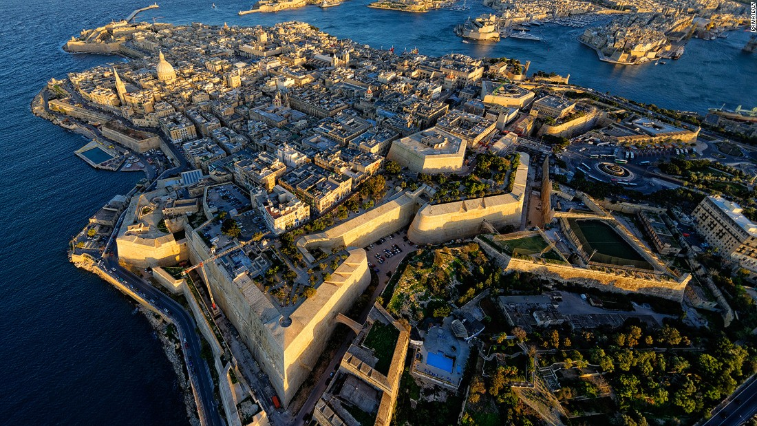 "Malta Airport tops the list for the first time this year. ""Approached from a churning blue sea, the tiny, isolated rocky island nation suddenly appears,"" says PrivateFly judge Joe Sharkey."