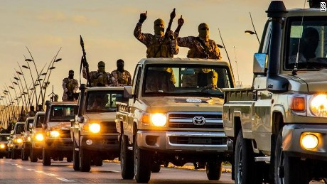 ISIS released still pictures purporting to show massive parade of their militants in the city of Sirte, Libya