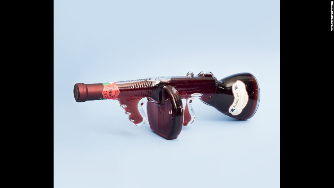 A wine bottle shaped like a machine gun.