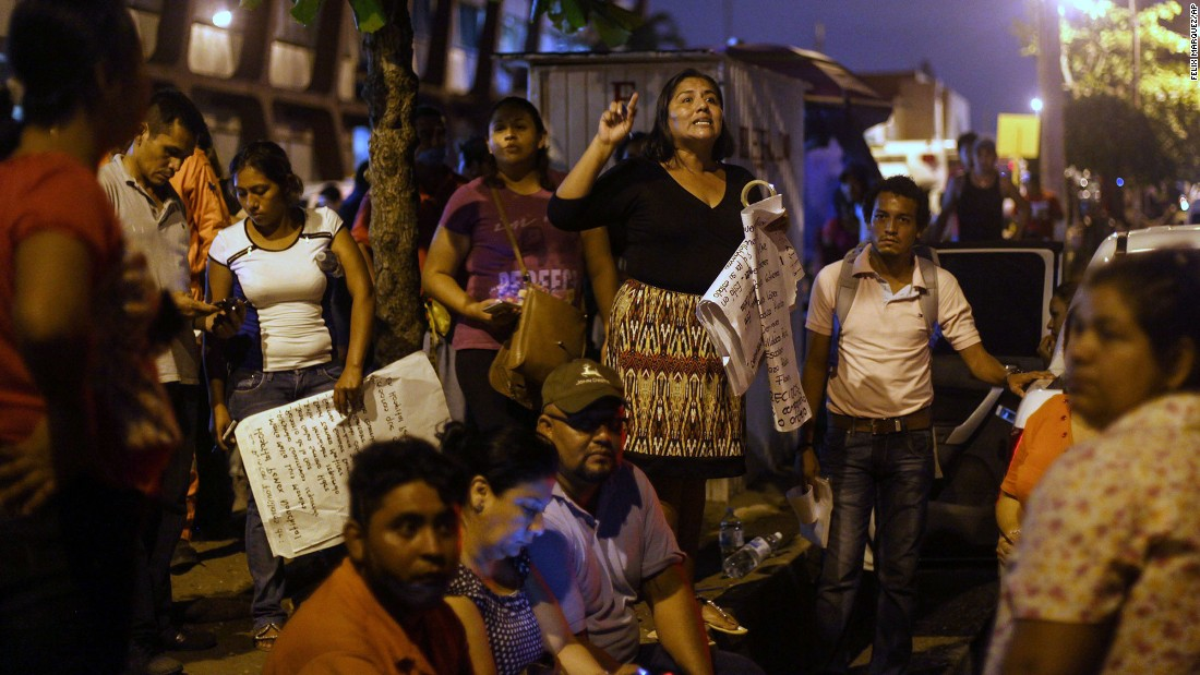 Relatives of missing plant workers demand news about loved ones outside a hospital in Coatzacoalcos.