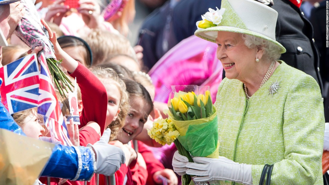 Queen Elizabeth II acknowledges the crowd as she celebrates her 90th birthday in Windsor, England, on April 21, 2016.