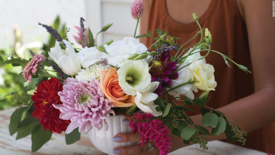 Song said she loves working with seeded eucalyptus leaves because they have weight and usually spill over the vase, adding volume to the bouquet.