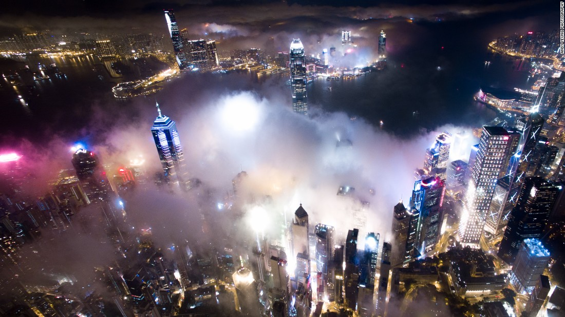 """I've seen a lot of amazing fog-themed photographs taken in the daytime during the fog season,"" Yeung says. ""I thought it would be interesting to capture Hong Kong in the thick mist at nighttime."""
