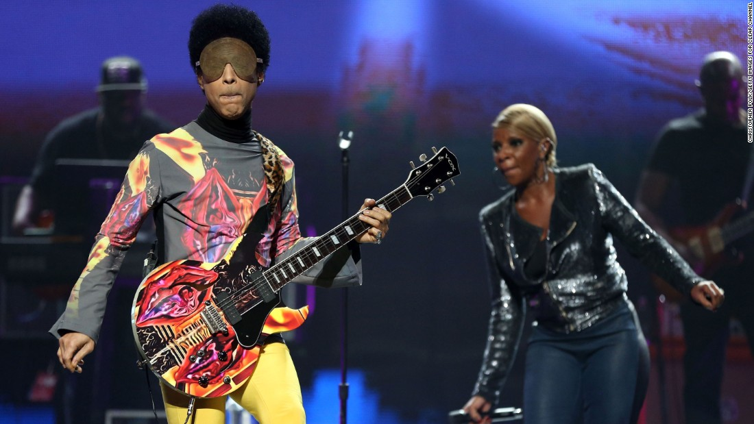 Prince on stage with singer Mary J. Blige during the 2012 iHeartRadio Music Festival in Las Vegas.